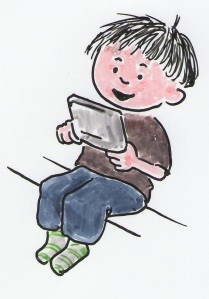 Seated young boy is playing a portable video game..