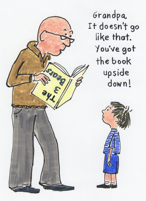 child telling grandpa he is holding the book upside down.