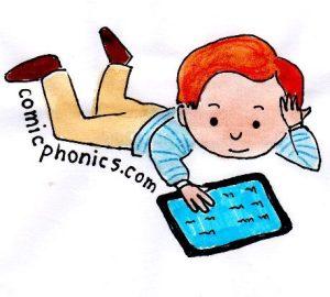 Boy on floor reading an ebook on his tablet.