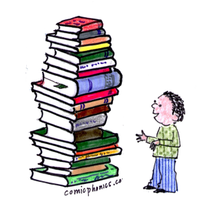 Preschooler looking at a tall stack of books.