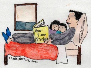Dad reading to children in bed