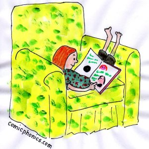 red headed girl in easy chair reading, legs up